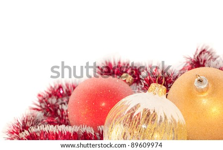 Christmas decoration: white, gold and red balls and garland on white background