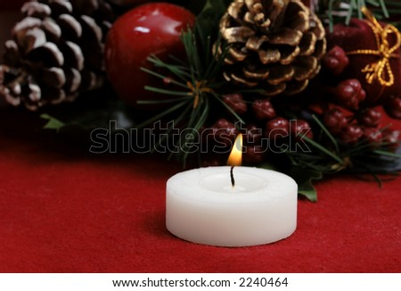 Christmas decoration, with a lit candle