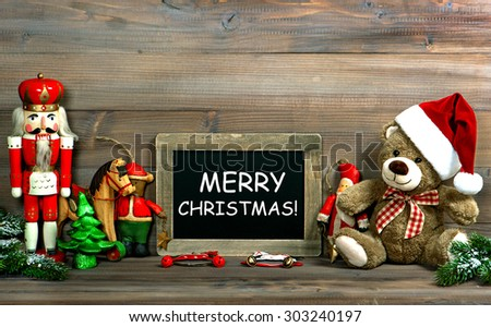 Christmas decoration with antique toys and blackboard. Vintage style toned picture with sample text Merry Christmas