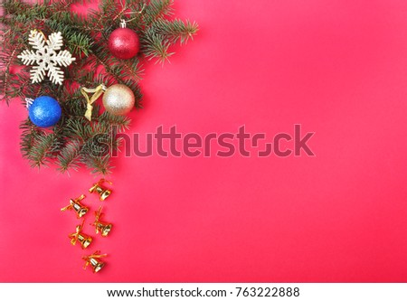 Christmas decoration with Beautiful gold bells, colorful balls and ribbons on red background. #763222888
