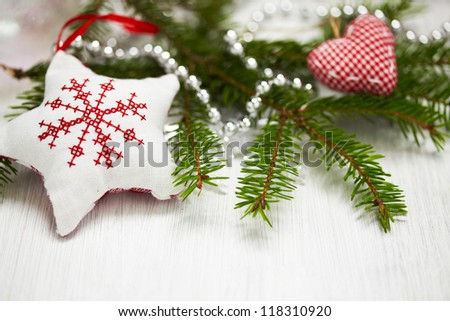 Christmas decoration with branch of Christmas tree and star
