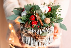 Christmas decoration with carnations, chrysanthemums santini, brunia and fir. Christmas spirit and mood