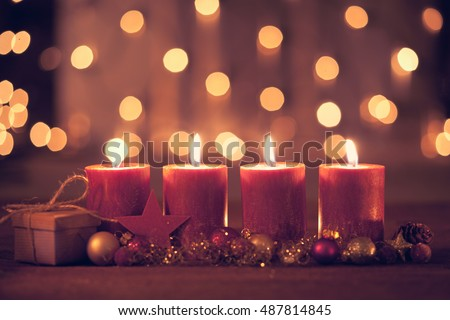 christmas decoration with christmas bauble and candle for advent season four candles burning #487814845