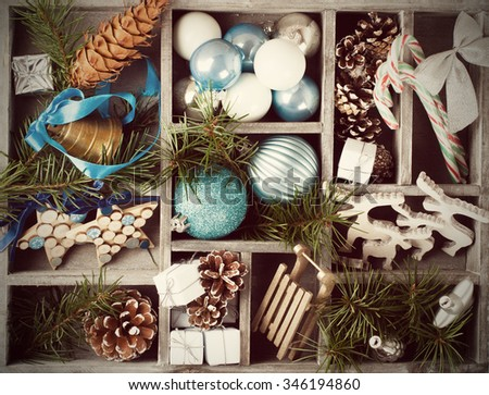 Christmas decoration with Christmas tree branches in wooden box. Winter holidays concept.  Retro style toned. #346194860