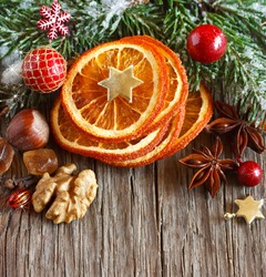 Christmas decoration with dried orange slices, nuts and spices.