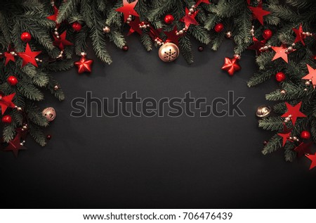 Christmas decoration with fir branches and red berries on a dark background #706476439