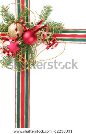 Christmas Decoration with fir branches,baubles and ribbon.