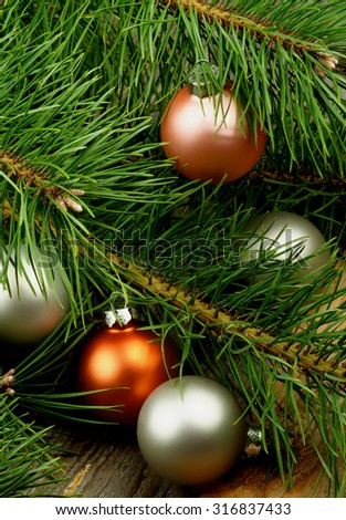 christmas decoration with fluffy green pine branches and five pastel colored baubles closeup on rustic wooden - Pastel Green Christmas Decorations
