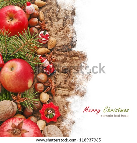Christmas decoration with fruit and nuts on the wooden background
