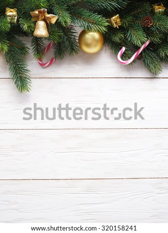 Christmas decoration with fur and baubles on old wood. #320158241