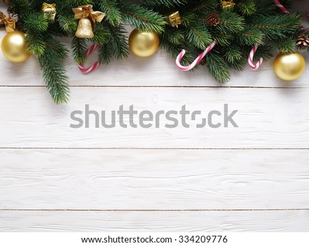 Christmas decoration with fur and baubles on old wood. #334209776