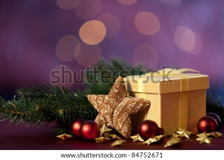 christmas decoration with gift and lights in background