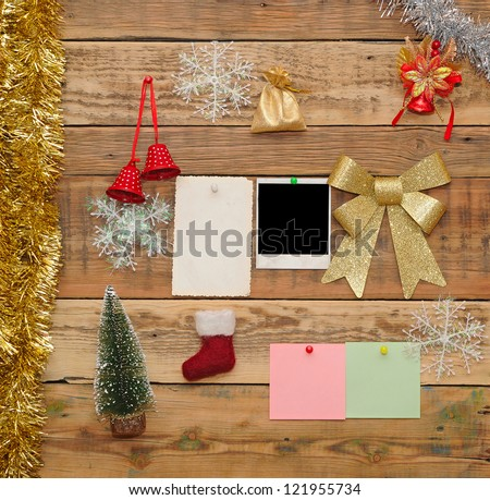 Christmas decoration with old photo frame on the wooden wall