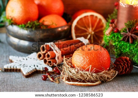 Christmas decoration with oranges and hay wreath.