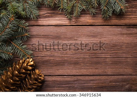 Christmas decoration with pine on a wooden table, as a background #346915634