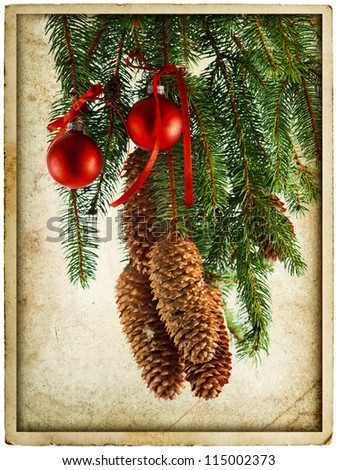 christmas decoration with red balls and fir tree branch. vintage card concept