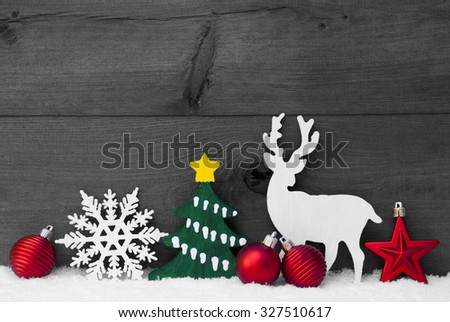 Christmas Decoration With Reindeer On White Snow. Green Christmas Tree, Snowflake And Red Christmas Balls. Brown, Rustic, Vintage Wooden Background For Copy Space. Black And White Christmas Card