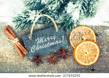 Christmas decoration with slate board, over wooden background - Shutterstock ID 227610292