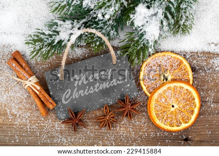 Christmas decoration with slate board, over wooden background - Shutterstock ID 229415884