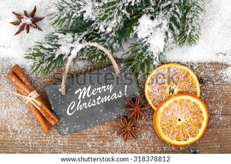 Christmas decoration with slate board, over wooden background - Shutterstock ID 318378812