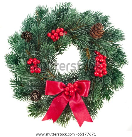 Christmas decoration wreath with red holly berries isolated on white background