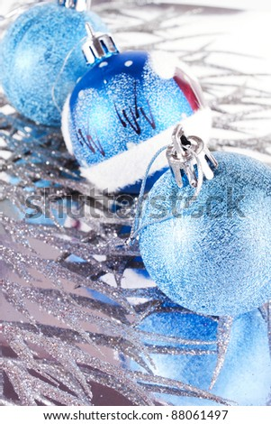 Christmas decorations against the backdrop of snowy branches