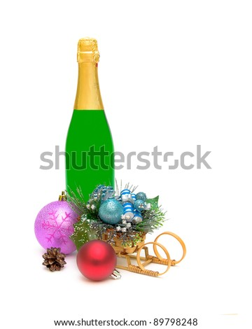 Christmas decorations and a bottle of champagne close-up on white background