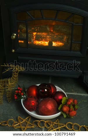Christmas Decorations and Baubles in front of a home fire