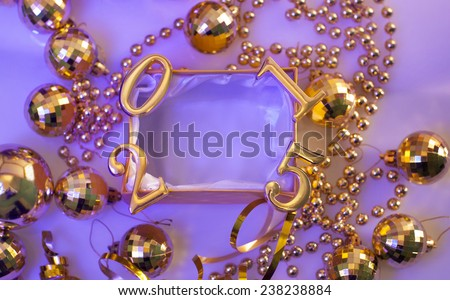 Christmas decorations and figures in gold color on a purple background