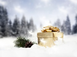 Christmas decorations and gift box in snow - firs in the background