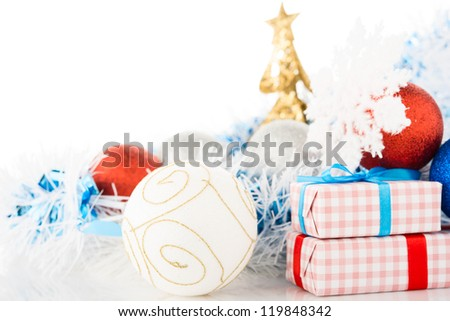 Christmas decorations and gifts on white background.