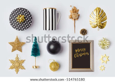 Christmas decorations and objects in black and gold for mock up template design.View from above. Flat lay