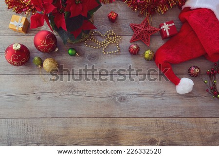 Christmas decorations and ornament on wooden background. View from above with copy space