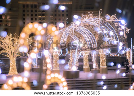 Christmas decorations at the Manege Square in Moscow. Soft focus.