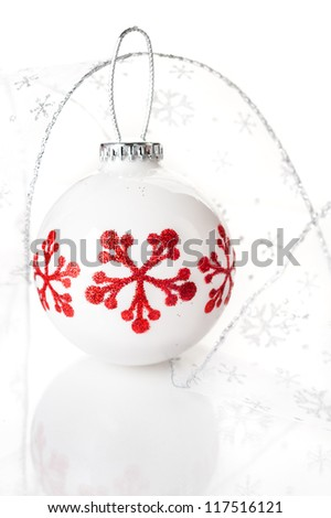 Christmas decorations:  ball and a ribbon with silver snowflakes