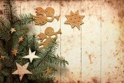 Christmas decorations.Christmas angels with the stars and christmas tree/Vintage christmas background/christmas card with paper decorations