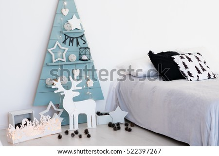 Christmas decorations christmas stylish. Blue wood tree with lights and other decoration, deer, stars and cones.