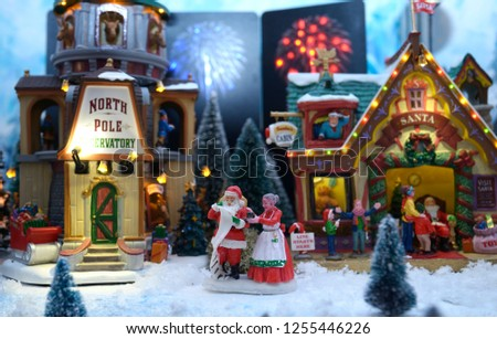 Christmas decorations, dummy toys, set on a miniature buildings background