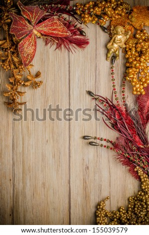 Christmas decorations frame on a wooden board.