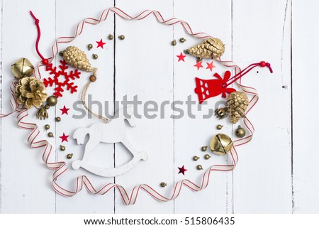 christmas decorations frame with rocking horse on white wooden table background 515806435