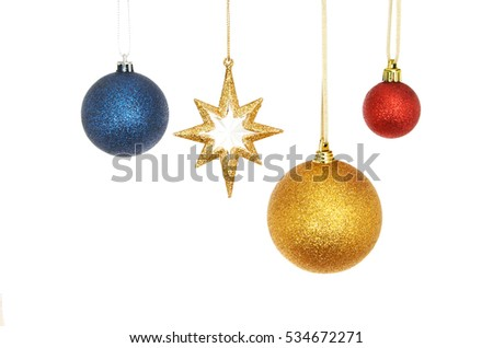 d02acfe26c3d Christmas decorations gold glitter star with blue, red and gold baubles  isolated against white #