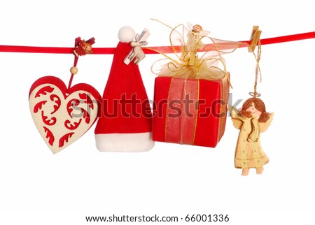 christmas decorations hanging on clothesline isolated on white