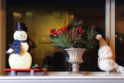 Christmas Decorations in a Window Sill.  Merry and Bright Decor.  Merry Christmas. Snowman, Holly, Snow Owl