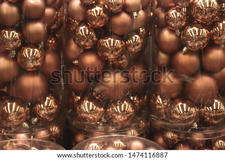 Christmas decorations in an interior decoration shop: bronze baubles