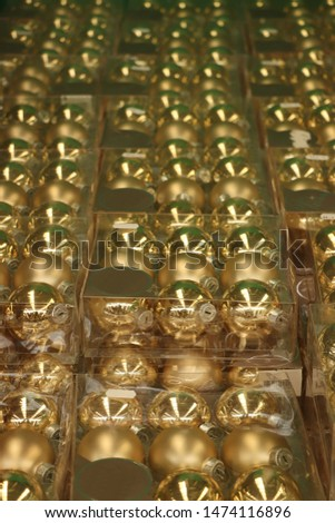 Christmas decorations in an interior decoration shop: Golden baubles