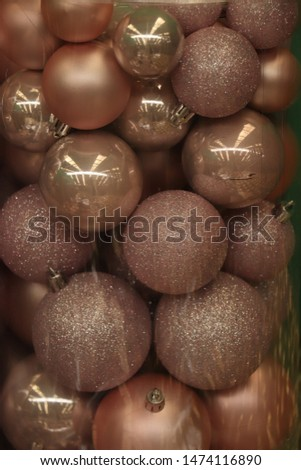 Christmas decorations in an interior decoration shop: pink baubles