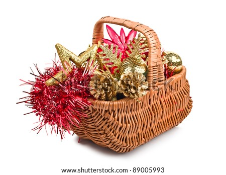 Christmas decorations in basket isolated on white background