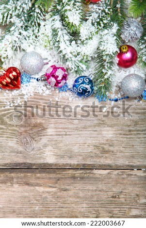 Christmas decorations in the snow on the wooden background #222003667