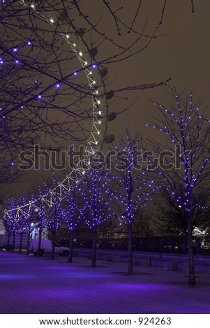 Christmas decorations in the trees with the London Eye in the background