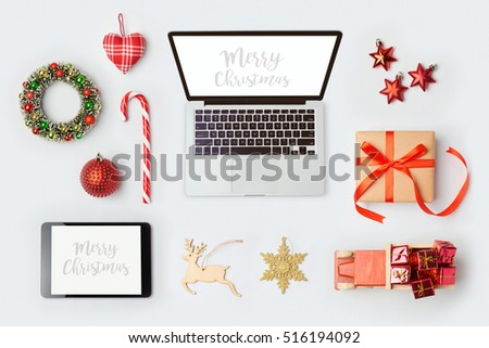Christmas decorations, laptop computer and objects for mock up template design.View from above. Flat lay
